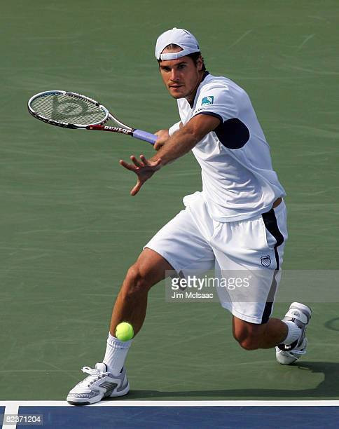 Tommy Haas of Germany returns a shot to Alejandro Falla of Colombia during their quarterfinal match at the Legg Mason Tennis Classic at the William...