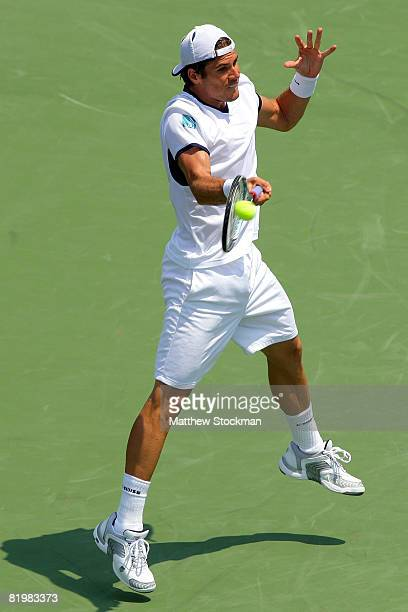 Tommy Haas of Germany returns a shot to Gilles Simon of France during the Indianapolis Tennis Championships at the Indianapolis Tennis Center July 18...