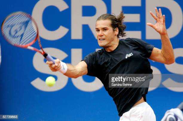 Tommy Haas of Germany returns a shot to Nicolas Almagro of Spain during the BMW Open tournament on April 26 2005 in Munich Germany