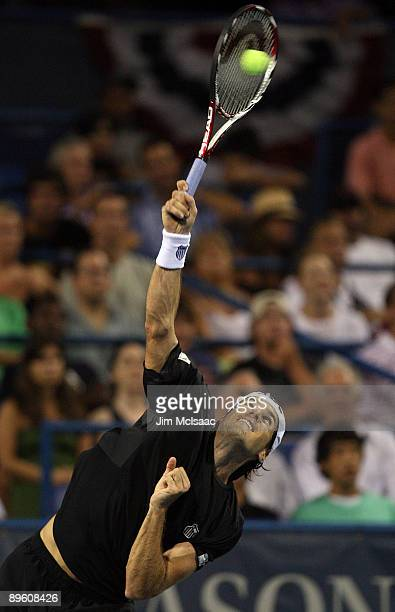Tommy Haas of Germany serves to Frank Dancevic of Canada during Day 2 of the Legg Mason Tennis Classic at the William H.G. FitzGerald Tennis Center...