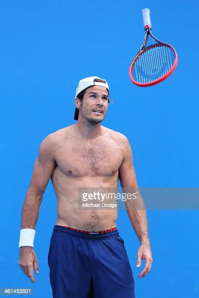 Tommy Haas of Germany throws his racquet in the air during his training session ahead of the 2014 Australian Open at Melbourne Park on January 9 2014...