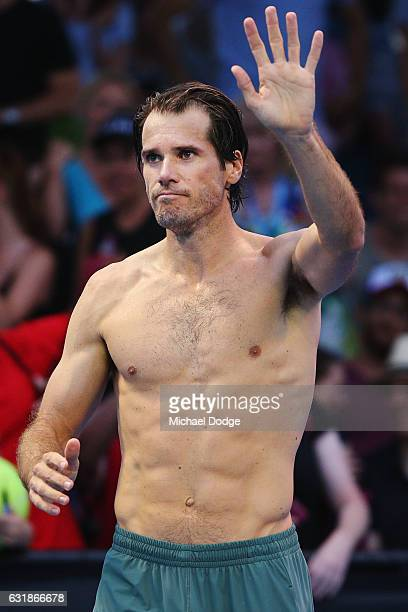 Tommy Haas of Germany waves to fans after retiring in his first round match against Benoit Paire of France on day two of the 2017 Australian Open at...