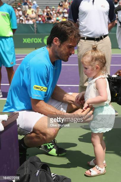 Tommy Haas of Germany with his daughter Valentina after his straight set victory against Alexandr Dolgopolov of the Ukraine during their third round...