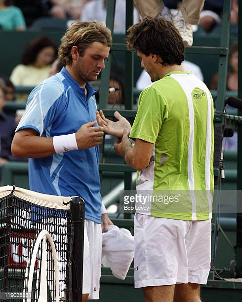Tommy Haas shows Mardy Fish his wrist injury that caused him to retire in the 1st set Mardy Fish defeated Tommy Haas 41 in semi finals actionApril 15...