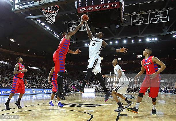 Tommy Hamilton IV of the DePaul Blue Demons defends as Ben Bentil of the Providence Friars goes to the basket in the first half on February 27 2016...