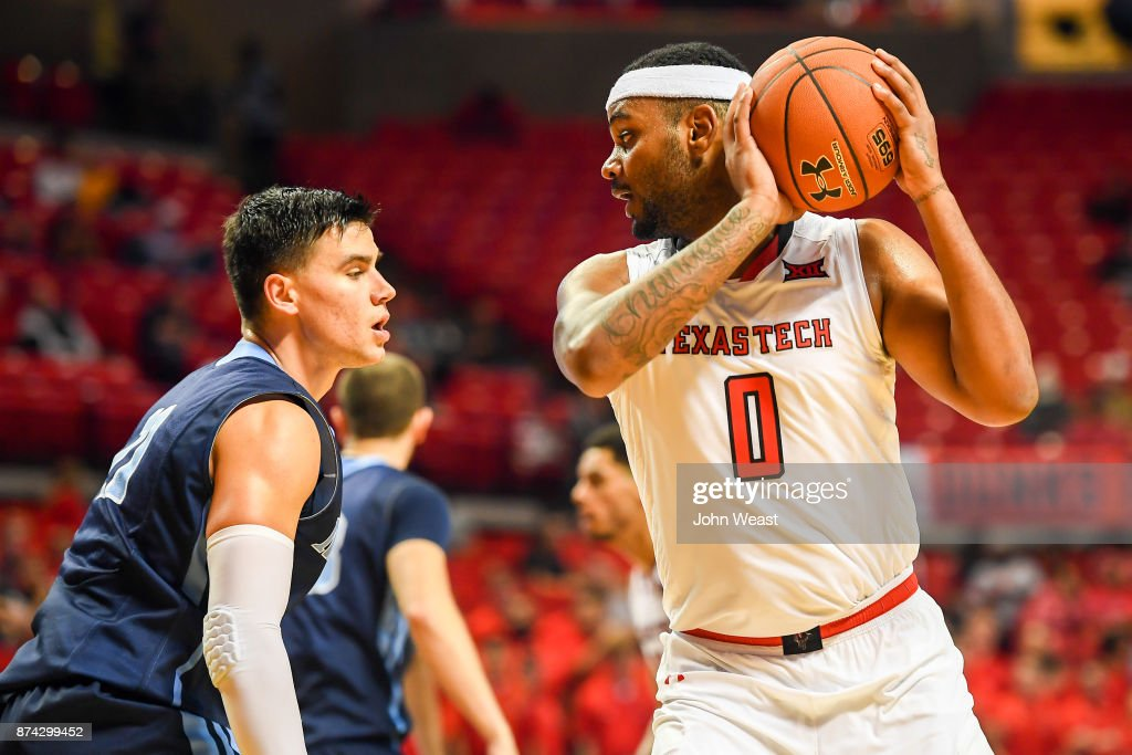 Tommy Hamilton IV #0 of the Texas Tech Red Raiders handles the ball against Ilija Stojiljkovic #11 of the Maine Black Bears during the game on November 14, 2017 at United Supermarkets Arena in Lubbock, Texas. Texas Tech defeated Maine 83-44.