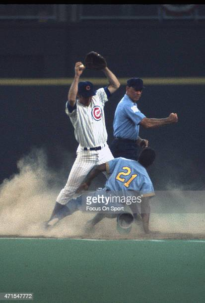 Tommy Harper of the Milwaukee Brewers and the American League AllStars is tagged out after colliding at second base with Glenn Beckert of the Chicago...