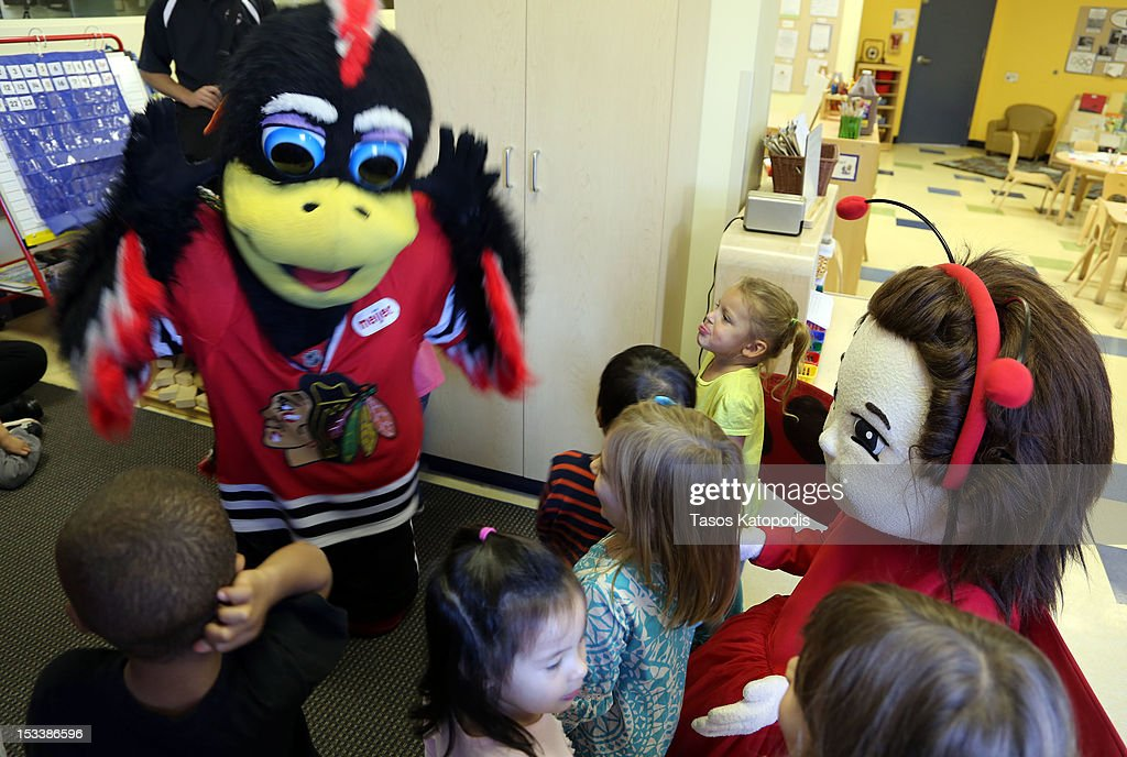 Tommy Hawk and Lady Bug Girl play with children at Bright Horizons on October 4, 2012 in Chicago, Illinois.
