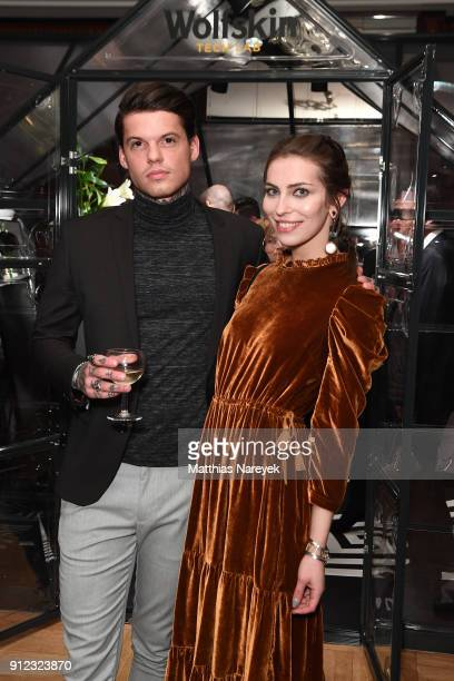 Tommy Hey and Masha Sedgwick attend the Wolfskin Tech Lab x Gianni Versace retrospective opening event at Kronprinzenpalais on January 30 2018 in...