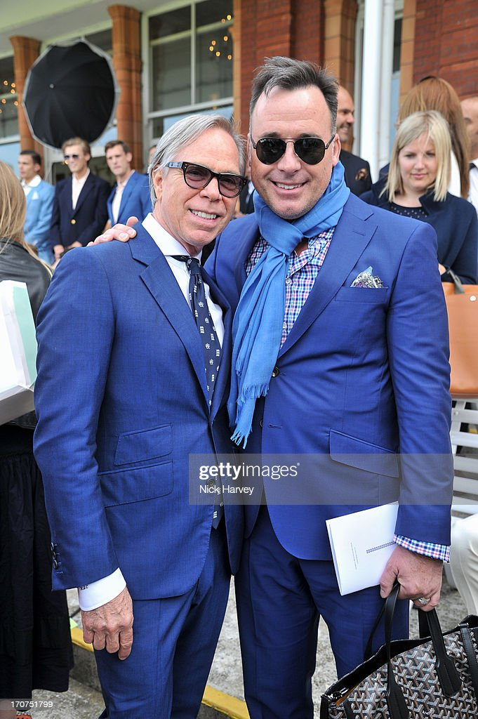 Tommy Hilfiger (L) and David Furnish attend the Savile Row & St James' Presentation during the London Collections: MEN SS14 at Lord's Cricket Ground on June 17, 2013 in London, England.