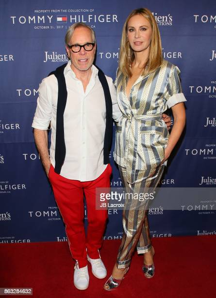 Tommy Hilfiger and Dee Ocleppo attend Julien's Auctions and Tommy Hilfiger VIP reception on October 19 2017 in Los Angeles California
