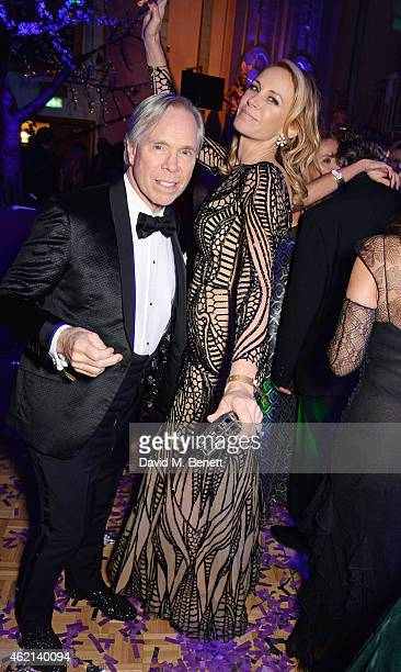 Tommy Hilfiger and Dee Ocleppo attend Lisa Tchenguiz's 50th birthday party at the Troxy on January 24 2015 in London England