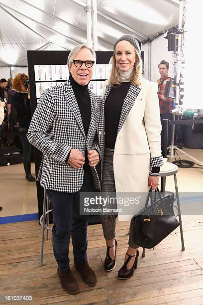 Tommy Hilfiger and Susie Hilfiger pose backstage at the Tommy Hilfiger Fall 2013 Men's Collection fashion show during MercedesBenz Fashion Week at...