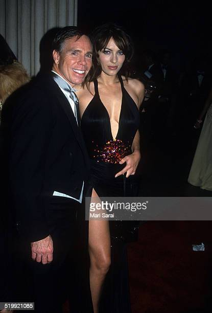 Tommy Hilfiger and Elizabeth Hurley at the Metropolitan Museum's Costume Institute gala exhibition New York New York December 6 1999