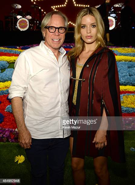 Tommy Hilfiger and Georgia May Jagger backstage at Tommy Hilfiger Women's during MercedesBenz Fashion Week Spring 2015 at Park Avenue Armory on...