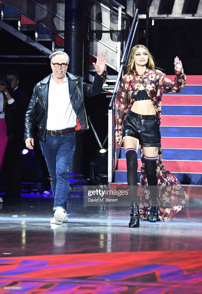 Tommy Hilfiger (L) and Gigi Hadid walk the runway at the Tommy Hilfiger TOMMYNOW Fall 2017 Show during London Fashion Week September 2017 at The Roundhouse on September 19, 2017 in London, England.