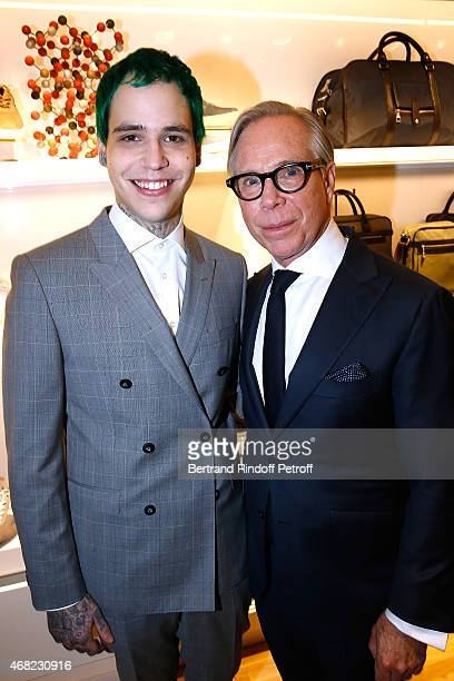 Tommy Hilfiger and his son Richard Hilfiger attend the Tommy Hilfiger Boutique Opening at Boulevard Capucines on March 31 2015 in Paris France