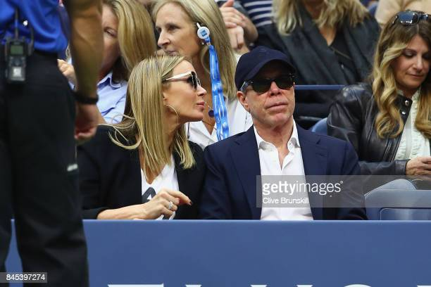 Tommy Hilfiger and his wife Dee Ocleppo watch the Men's Singles finals match between Kevin Anderson of South Africa and Rafael Nadal of Spain on Day...