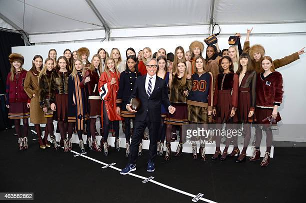 Tommy Hilfiger and models backstage at Tommy Hilfiger Women's Collection during MercedesBenz Fashion Week Fall 2015 at Park Avenue Armory on February...