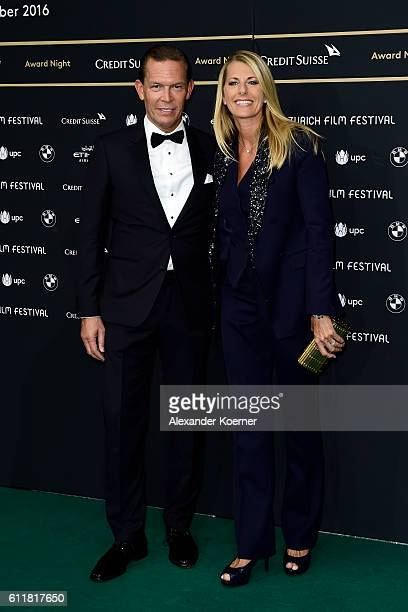 Tommy Hilfiger and PVH Daniel Grieder and his wife Sandra attend the Award Night during the 12th Zurich Film Festival on October 1 2016 in Zurich...