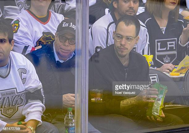 Tommy Hilfiger and Ricky Hil attend a hockey game between the Winnipeg Jets and the Los Angeles Kings at Staples Center on March 29 2014 in Los...