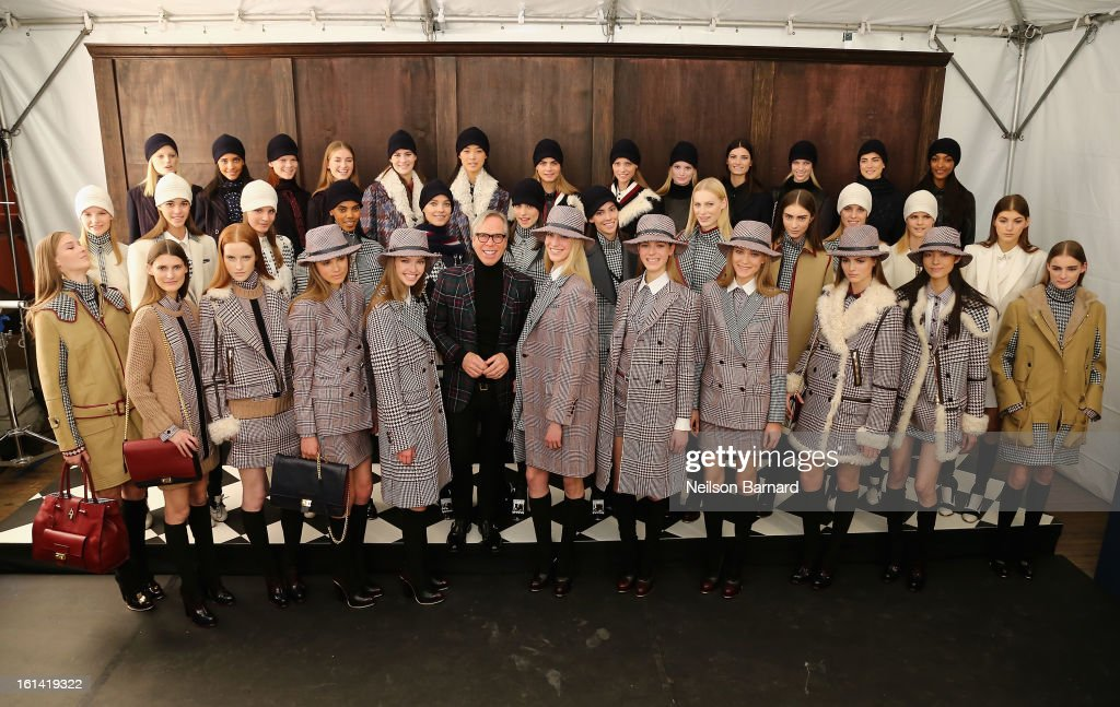 Tommy Hilfiger (center) backstage at the Tommy Hilfiger Fall 2013 Women's Collection fashion show during Mercedes-Benz Fashion Week at the Park Avenue Armory on February 10, 2013 in New York City.