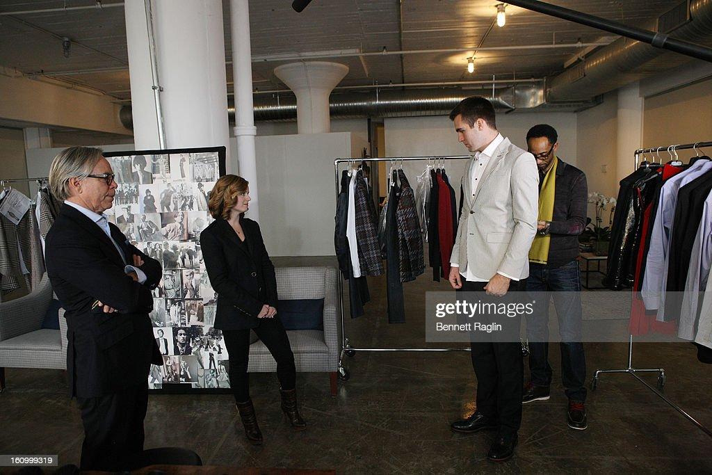 Tommy Hilfiger, Baltimore Ravens Quarterback Joe Flacco (R) and wife Dana Flacco get ready for Fashion Week at Hudson Studios on February 7, 2013 in New York City.