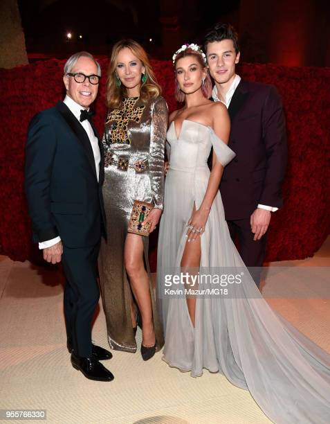 Tommy Hilfiger Dee Hilfiger Hailey Baldwin and Shawn Mendes attend the Heavenly Bodies Fashion The Catholic Imagination Costume Institute Gala at The...