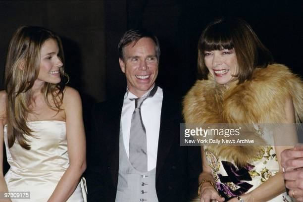 Tommy Hilfiger is flanked by Aerin Lauder and Vogue editor Anna Wintour at the Costume Institute Gala Rock Style an exhibit of rock 'n' roll fashions...