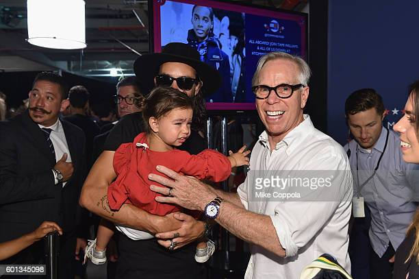 Tommy Hilfiger poses backstage with Harley HilfigerHash and Steve Hash at the #TOMMYNOW Women's Fashion Show during New York Fashion Week at Pier 16...