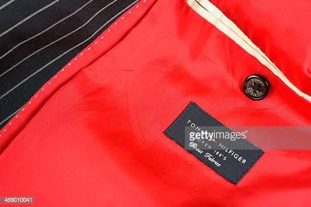 tommy hilfiger suit - tommy hilfiger designer label stock pictures, royalty-free photos & images