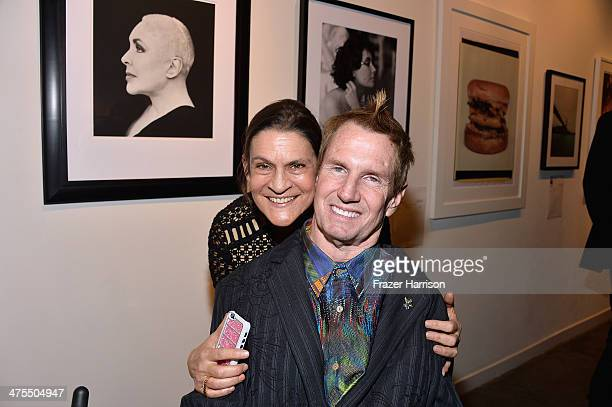 Tommy Hollenstein and Aileen Getty attend The Elizabeth Taylor AIDS Foundation Art Auction Benefit Presented By Wilding Cran Gallery on February 27...