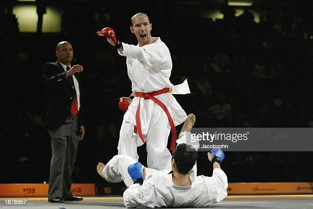 Tommy Hood of the USA celebrates after defeating Alonso Murayama of Mexico during the karate portion of the Titan Games at the Events Center at San...