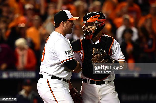 Tommy Hunter of the Baltimore Orioles talks with Nick Hundley after defeating the Detroit Tigers 123 in Game One of the American League Division...