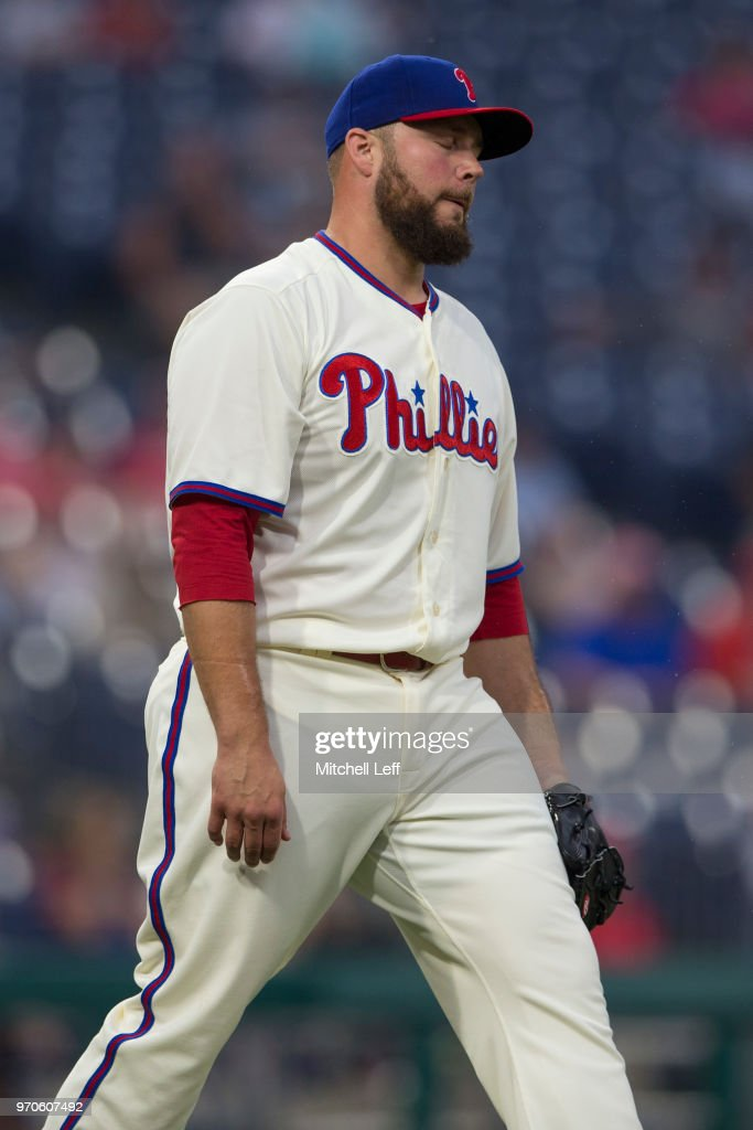 Tommy Hunter #40 of the Philadelphia Phillies reacts after committing an error in the top of the ninth inning against the Milwaukee Brewers at Citizens Bank Park on June 9, 2018 in Philadelphia, Pennsylvania. The Brewers defeated the Phillies 12-3.