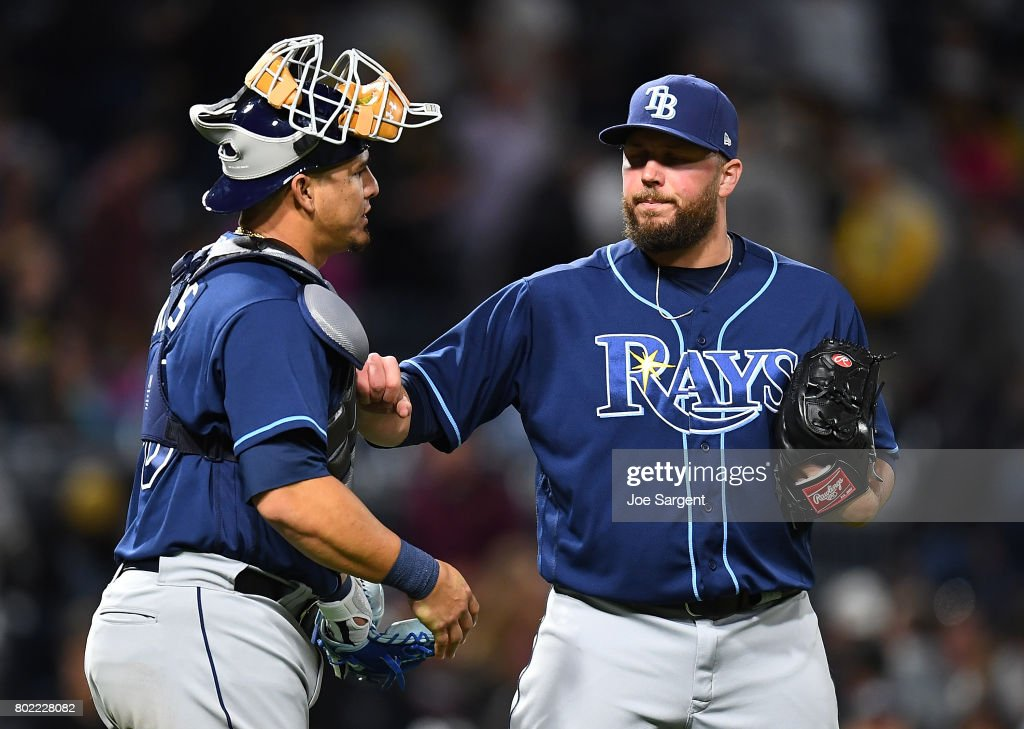 Tommy Hunter #49 of the Tampa Bay Rays celebrates with Wilson Ramos #40 after a 4-2 win over the Pittsburgh Pirates at PNC Park on June 27, 2017 in Pittsburgh, Pennsylvania.
