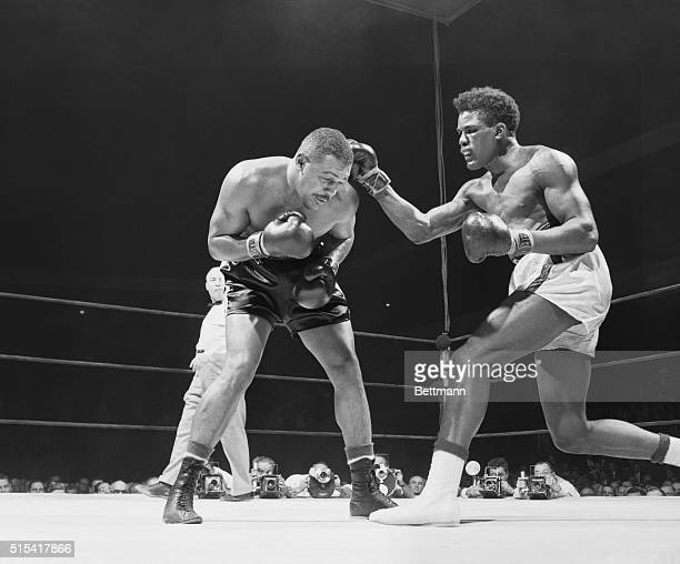"""Tommy """"Hurricane"""" Jackson clips Big Bob Baker on the head tonight with a right in the sixth round of their Garden bout. Jackson scored an upset by..."""
