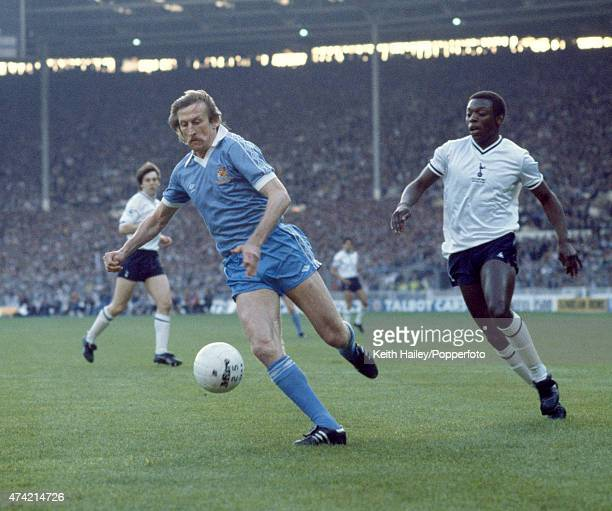 Tommy Hutchison of Manchester City moves past Garth Crooks of Tottenham Hotspur during the FA Cup Final Replay at Wembley Stadium in London 14th May...