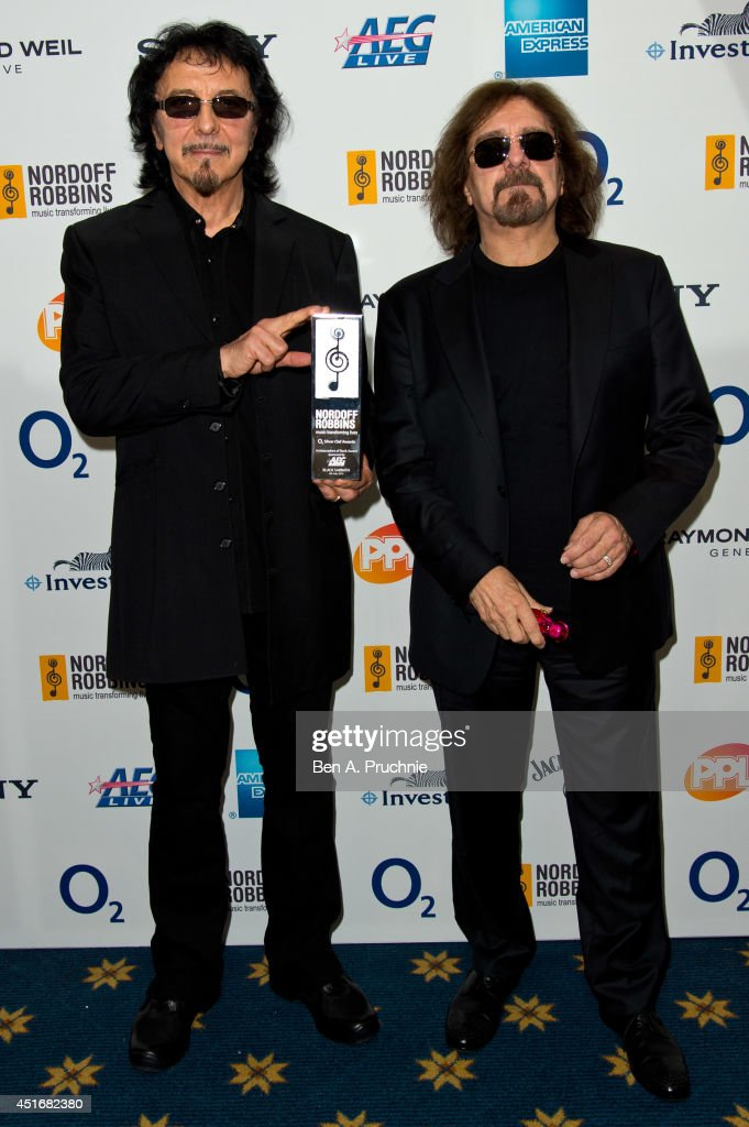 Tommy Iommi and Geezer Butler attends the Nordoff Robbins 02 Silver Clef awards at London Hilton on July 4, 2014 in London, England.