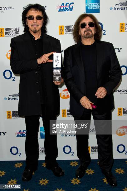 Tommy Iommi and Geezer Butler attends the Nordoff Robbins 02 Silver Clef awards at London Hilton on July 4 2014 in London England