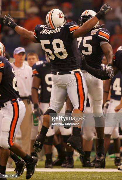 Tommy Jackson and Stanley McClover of the Auburn Tigers celebrate during a game againt the Virginia Tech Hokies at the Nokia Sugar Bowl on January 3...