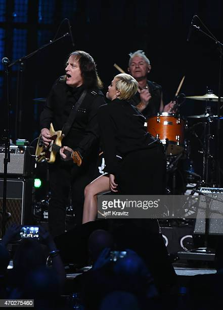 Tommy James and Miley Cyrus perform with inductee Joan Jett and the Blackhearts onstage during the 30th Annual Rock And Roll Hall Of Fame Induction...
