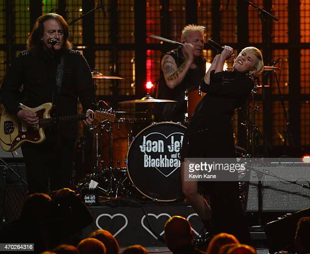 Tommy James and Miley Cyrus perform with Joan Jett the Blackhearts onstage during the 30th Annual Rock And Roll Hall Of Fame Induction Ceremony at...