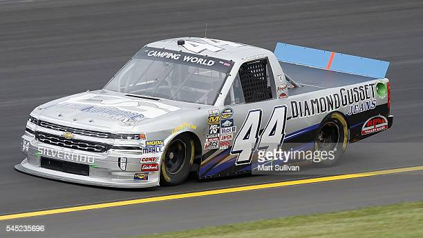 Tommy Joe Martins driver of the Diamond Gusset Jeans Chevrolet practices for the NASCAR Camping World Truck Series Buckle Up In Your Truck 225 at...