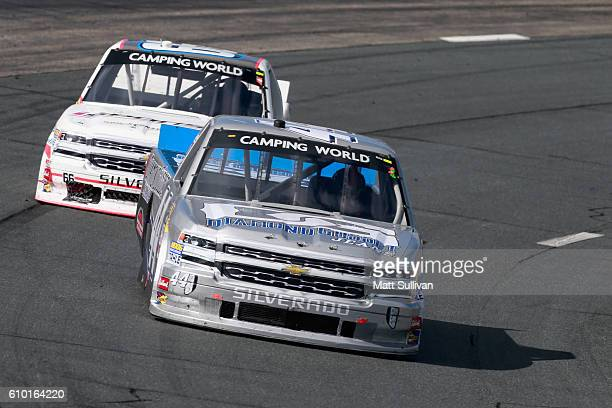 Tommy Joe Martins driver of the Diamond Gusset Jeans Chevrolet leads Jordan Anderson driver of the Columbia SC/Bolen Motorsports Chevrolet during the...