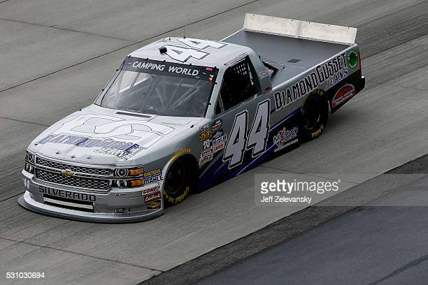 Tommy Joe Martins driver of the Diamond Gusset Jeans/MTech Control Chevrolet practices for the NASCAR Camping World Truck Series at Dover...