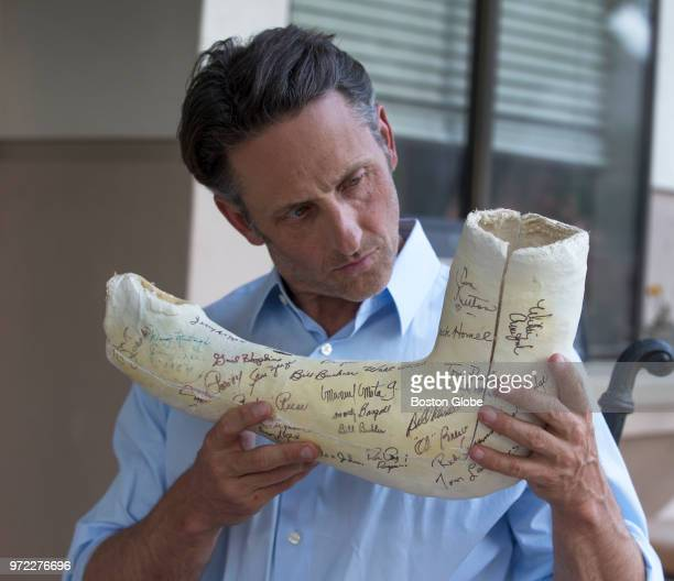 Tommy John III holds the original cast signed by the 1974 Los Angeles Dodgers from the surgery performed on his father, former Major League Baseball...