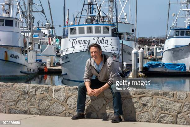 Tommy John III poses for a portrait in front of a fishing vessel named after his father, former Major League Baseball pitcher Tommy John, in San...