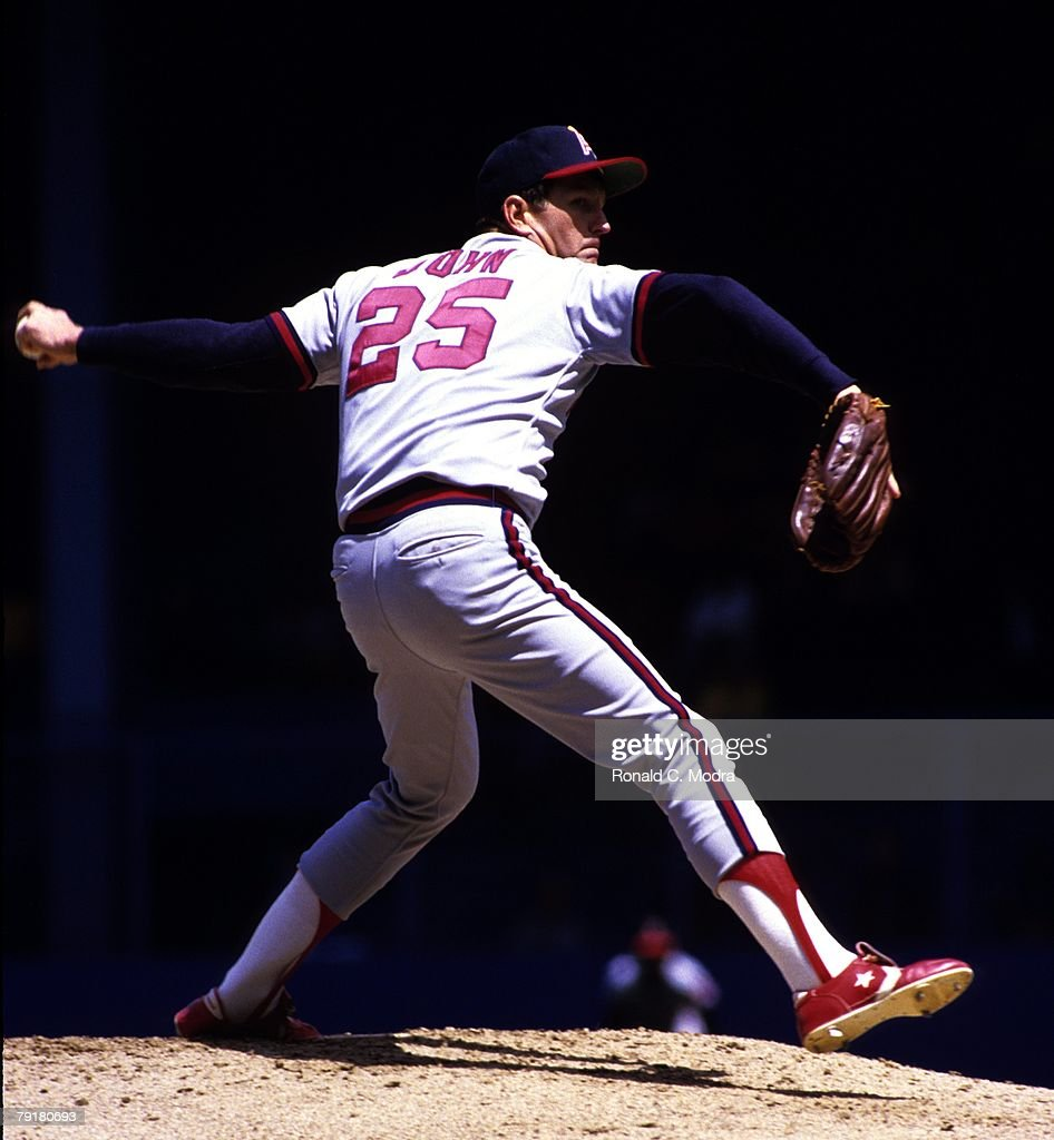 Tommy John #25 of the California Angels pitching during a game against the Detroit Tigers in May 1984 in Detroit, Michigan.
