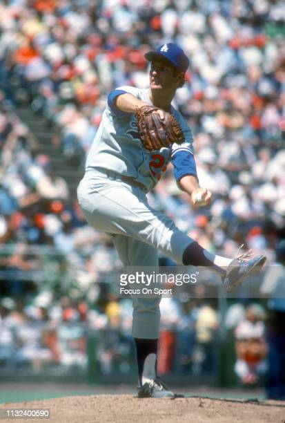 Tommy John of the Los Angeles Dodgers pitches against the Philadelphia Phillies during a Major League Baseball game circa 1977 against the...